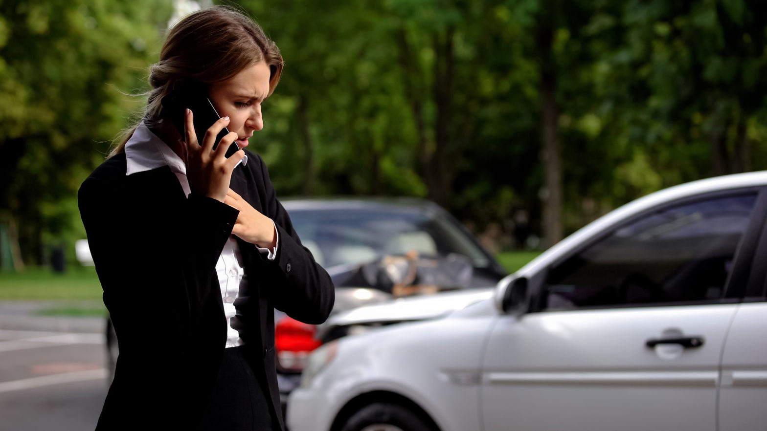 A woman calling Personal Injury Attorneys